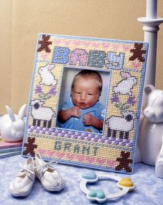 Baby's First Frame ePattern - The combination of cuddly baby animals and your little one's picture makes this frame a must-have for the nursery. Amidst pretty pastels and a delightful design, your favorite baby photo will be preciously preserved. Canvas Picture Frames, Plastic Picture Frames, Photo Canvas, Canvas Frame, Plastic Canvas Stitches, Plastic Canvas Crafts, Plastic Canvas Patterns, String Wall Art, Nail String