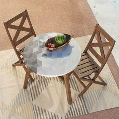 Add a little art to your outdoor space with the Mosaic Tiled Bistro Table. Its concrete tiles are carefully inlaid by hand onto a FSC®-certified hardwood base, for a unique look both indoors and out.