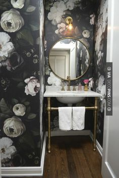 So cool - Powder Room Makeover from Cupcakes and Cashmere. Love the large roses on the wall.