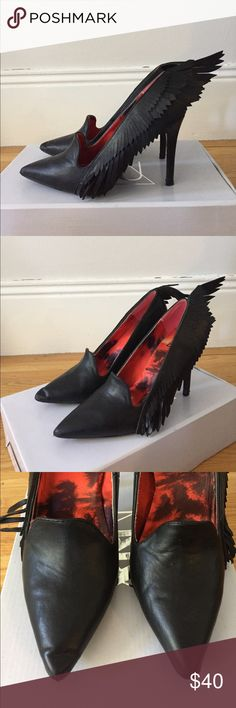 YRU stilettos with wing embellishment, size 9 Super fun and unique YRU shoes with wing-like embellishment. Black. Worn twice. The wings came a bit distorted even fresh out of the box, so have been adjusting them since. Size 9 (euro 40). YRU Shoes Heels