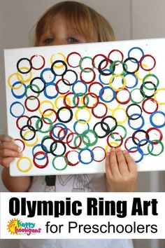 Easy Olympic Craft for Kids - kids can stamp up a piece of Olympic Ring Art to hang in the playroom or the classroom in honour of the Summer or Winter Olympic games - Happy Hooligans Toddler Art, Toddler Preschool, Toddler Crafts, Toddler Sports, Kids Sports, Preschool Art Projects, Preschool Art Activities, Craft Kids, Kids Crafts