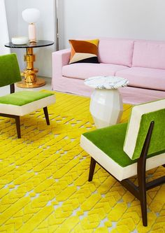 colorful living room, bright yellow rug, pink sofa, lime green chairs, pantone meadowlark, bright yellow, lemon yellow