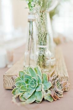 Wooden plank as a table runner on long wedding table.