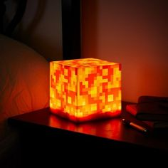 We hope you enjoy the fact that it doesn't actually contain lava. Perfect for lava enthusiasts and Minecraft fans alike, this mood light gives you all the warm fuzzies without the burning sensation. Minecraft Room Decor, Minecraft Crafts, Minecraft Furniture, Boys Minecraft Bedroom, Minecraft Decorations, Video Game Bedroom, Video Game Rooms, Gamer Bedroom, Lego Bedroom