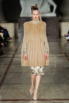I love my vintage camel wool cape. This would be the next level. Gorge fur cape-- Zac Posen