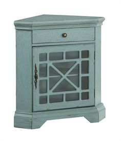 Bayberry Blue One Drawer And One Door Corner Cabinet G8699 - Bayberry Blue One Drawer And One Door Corner Cabinet G8699Add a touch of color with our corner cabinet in a cheerful Bayberry Blue rub-through finish. Fretwork overlays the clear glass fronted door so you can see your items stored within, and with an upper drawer to keep other items close at hand. Ideal for kitchen, bath or any open corner. Finish: Bayberry Blue Rub-ThroughUpc Code: 884904786990Cube Feet: 13.93Ups Size: 139Product…