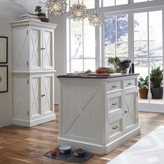 Provide a warm inviting cottage feel to your kitchen decor by choosing this Home Styles Seaside Lodge Hand Rubbed White Kitchen Pantry. Home Decor Kitchen, Decor, Seaside Lodge, White Kitchen Pantry, Kitchen Remodeling Projects, Home Styles, Havenside Home, White Kitchen Island, Stools For Kitchen Island
