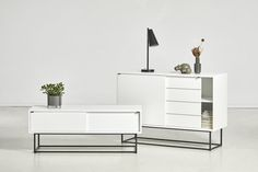 VIRKA - WOUD | The elegant sideboard is designed with sliding doors so it will never take up unnecessary space in your room. The strong geometrical frame elegantly lif ts the sideboard above the floor and adds lightness to the design. Inside the Virka sideboard has one adjustable shelf in each side with room to let cables pass out the back making the design both functional and minimalistic. Sideboard, Rooms To Let, Design Language, Adjustable Shelving, Sliding Doors, Nightstand, Shelf, Minimalist, Strong