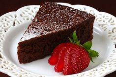 Flourless Chocolate Cake....only 3 ingredients...eggs. semi or bittersweet chocolate, butter...powdered sugar and/or berries to garnish