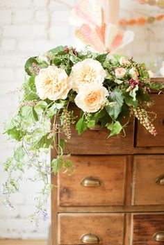 Lush, pale peach floral arrangement by Poppies & Posies.( I think the ivy makes these pale flowers pop).