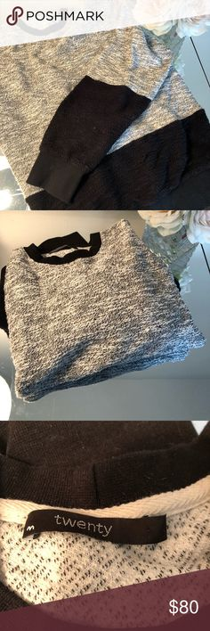 Unisex White and Black Sweatshirt Super comfy loose fit white and black sweatshirt with black panels on the bottom of the bodice and sleeves.  Excellent condition. I think it's actually men's, but I've been wearing it myself! Twenty Tops Sweatshirts & Hoodies