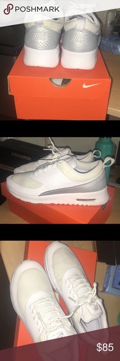 Nike Thea air max Worn 3 times! Gently worn and close to brand new. Nothing wrong with the other than they are white so they do get dirty fast. Just need to wipe them down and they're like new! Nike Shoes Sneakers