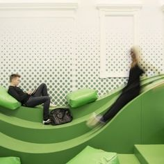 Wavy green lounge by Svet Vmes Architects replaces an old school entrance; great social engagement area