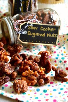 Spicy, sweet Slow Cooker Candied Nuts are the PERFECT gift idea for family and friends! Package up a handful of these rich and addictive glazed nuts in a mason jar, or layer the ingredients so folks can cook them up and experience the intoxicating, cinnamon-spiced aroma at home!