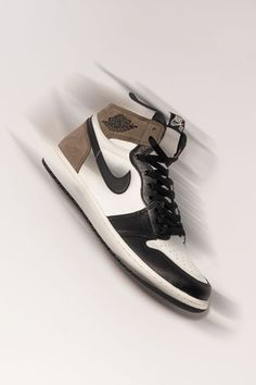"""One of the most popular non-original Air Jordan 1 colorways of the last few years is the """"Dark Mocha,"""" and it's easy to see why. The shoe combines elements of the Air Jordan 3 """"Mocha"""" and the Travis Scott x Air Jordan 1 from 2019."""