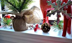 How I created my Christmas kitchen window vignette, where I installed a black and white no-sew faux Roman shade DIY project to keep year round! Christmas Wreaths, Christmas Decorations, Table Decorations, Holiday Decor, Black Christmas, Christmas Kitchen, Diy Craft Projects, Diy Crafts, Faux Roman Shades