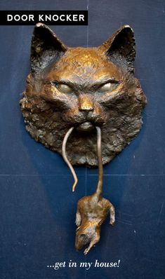 cat & mouse doorknocker: priced at $1150, this'll forever just be wishful thinking.