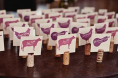 super creative! animals in different shades of purple on top of cork. via style me pretty.