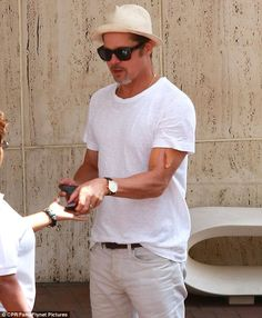 Taped up: Brad Pitt continued to sport bandages on his upper left arm on Thursday as he took teenage son Maddox Jolie-Pitt shopping in Beverly Hills, California