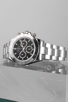 The Rolex Daytona (Ref. 116520) is the perfect tool watch for those with a taste for speed. Equipped with a calibre 4130 and a 70h power reserve, the Cosmograph Daytona is more reliable than a standard chronograph. This iconic timepiece also comes with a black dial featuring three chronograph subdials, a 40mm stainless steel case, a tachymeter benzel, an Oyster bracelet and a concealed deployant clasp. Cosmograph Daytona, Rolex Daytona, Buy Rolex, Rolex Models, Luxury Watch Brands, Stainless Steel Case, Chronograph, Rolex Watches