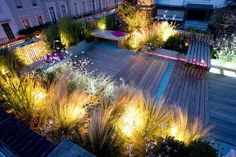 decked roof terrace garden at night by the amazing charlotte rowe, garden designer. Patio Lighting, Exterior Lighting, House Lighting, Lighting Ideas, Landscape Lighting Design, Retractable Pergola, Rooftop Patio, Holland Park, Terrace Garden