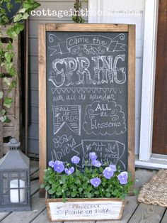 Chalkboard With Wooden Planter and Decorative Lantern