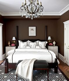 Chocolate brown walls set off the crisp details in this room designed by Tom Stringer. Photo: Werner Straube