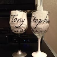 Wine glasses by Angela. These are the back of ones I made for friends wedding. The front is a bride and groom. $50/pair