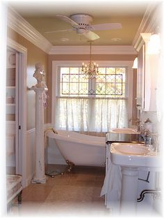 I want this bathroom...the tub, window,sink and woodwork...love love it.