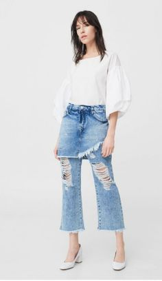 Mango's new jeans take a new approach to the skirt-over-pants idea by layering a denim skirt over a cropped flare. #fashion #style #dress #cloth