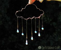 Rainy Days Suncatcher – A copper rain cloud hanging decoration with seven rain droplets made up of wire paddles and a glass beaded droplet. Rainy Days Suncatcher – A cop Wire Jewelry, Jewelery, Copper Wire Art, Copper Wire Crafts, Copper Metal, Cloud Art, House Ornaments, Snowman Ornaments, Rain Clouds