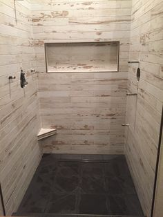 Wedi shower with 3x36 plank tile on wall. Black slate floor clean and beautiful