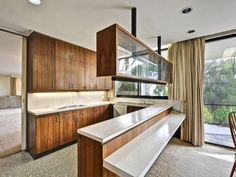 what a great kitchen - love that hanging cupboard
