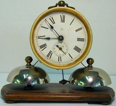 Antique made in Wurttenberg dual bell wood base alarm clock.