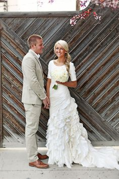Pretty ruffled wedding dress with sleeves