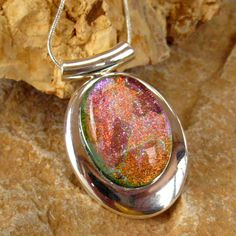 Dichroic Fused Glass in a Silver Setting, Oval Dichroic Glass Pendant - Morning Sunrise. $25.00, via Etsy.