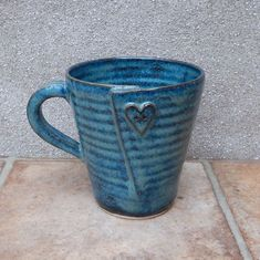Coffee mug..... with a button hand thrown stoneware ceramic