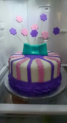 My first cake with a bow and sprays.