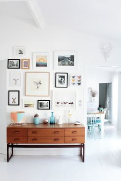 Gallery Art and Photo Wall display above a sideboard