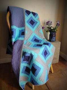 ~This is a reserved listing for a custom order for B.C.~ 50 x 75 Quilt featuring Kona cotton solids and a gorgeous, iridescent Rowan shot-cotton backing. Free-motion spiral quilted on a domestic sewing machine. 100% cotton batting and thread. Inspired by the Raspberry Dessert