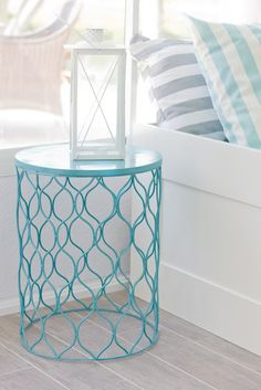 Spray paint a metal garbage can, flip it upside down for an instant end table. Check out the other design ideas. Love the simple bookshelf and coffee table!