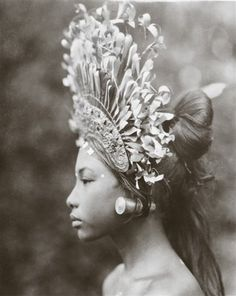 """Absolute Grace & Beauty. Circa 1930's. A towering headdress and plug earrings adorn a 1930s Balinese djanger dancer, part of a coed performance that was """"more of popular fun than of temple dance or disciplined art,"""" wrote Maynard Owen Williams in his March 1939 Geographic article, """"Bali and Points East."""""""