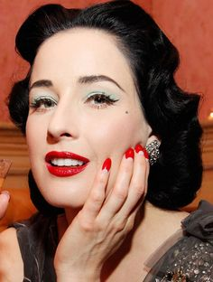 Perfect 50s eyeshadow on Dita. And perfect 40s manicure. I aspire to be this picture.