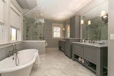 """Our company takes the word """"Custom"""" to the extreme. From the initial planning of the home to placing the front door keys into the homeowner's hands, all phases Interior Photo, Subway Tiles, Clawfoot Bathtub, Corner Bathtub, Custom Homes, Freestanding Bath, Building, Mandalay, House"""