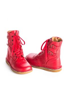 These candy red girls' boots will make a bold addition to school uniforms this fall, and bring a bolt of blazing red to holiday outfits during the winter months.  These boots are crafted from buttery soft Italian leather, and feature inner side zippers, lace up fronts, decorative outer buckles and punch seamed accents.Italian leatherRubber soleSide zipBy PePeExclusive to Little Skye