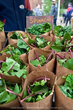 Paper bags of New Zealand spinach http://ourfarmjourney.com/iowa-farmers-markets/