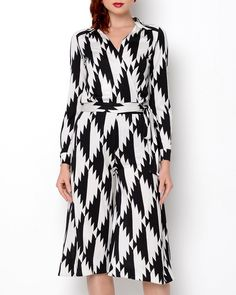 """Barras Jumpsuit in black-white by Diane Von Furstenberg $465 - $289 at Modnique. 100% Silk; Trim: 88% Viscose, 12% Silk. V-neck 3/4 sleeves Dry clean Fit: Classic fit All-silk fabric Two-tone, printed designs throughout Partially see-through Ties at waist Buttoned cuffs Ultra soft, comfortable fit Model is wearing size 4.  Model Measurements: Height: 5'9"""", Waist: 24"""", Hips: 34"""", Bust: 34""""."""