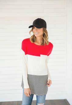 Suddenly Seams Red Striped Tee pairs a pop of color with our all time favorite, black & white stripes. This tee is perfect for transitioning into spring! || Bella Ella Boutique
