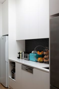 Butlers Pantry hidden from view in this streamlined kitchen, soft close drawers, skylights and a stunning hydraulic window leading to the garden. Black sinks and tapware compliment the large black framed window and matt black subway tiles Living Area, Living Spaces, Black Subway Tiles, Black Sink, Open Fires, Skylights, Timber Flooring, Butler Pantry, Beautiful Lights