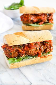 This Vegan Italian Meatball Sandwich recipe is healthy and gluten-free comfort food to the max! Tender meatballs are coated in a spicy basil marinara sauce and sandwiched between a crusty baguette.   CatchingSeeds.com